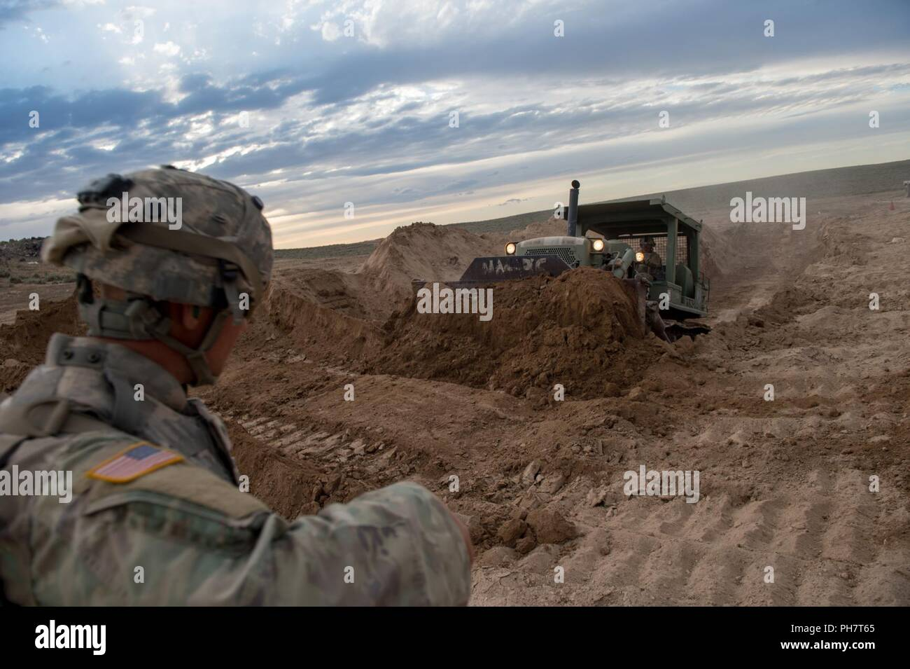 Engineers with the Idaho Army National Guard's 116th Brigade Engineer Battalion conduct training in fighting positions for crew-served weapon teams, M1 Abrams and M2 Bradley turret and hull defilades on June 17th, 2018, Orchard Combat Training Center, south of Boise, Idaho. Combat engineers with the 116th BEB participate in an eXportable Combat Training Capability rotation at the OCTC for its National Training Center rotation in June 2019.More than 3,000 Soldiers from at least five Army National Guard states, the U.S. Army, the U.S. Army Reserve and the British Army Reserve's 103rd Regiment R Stock Photo