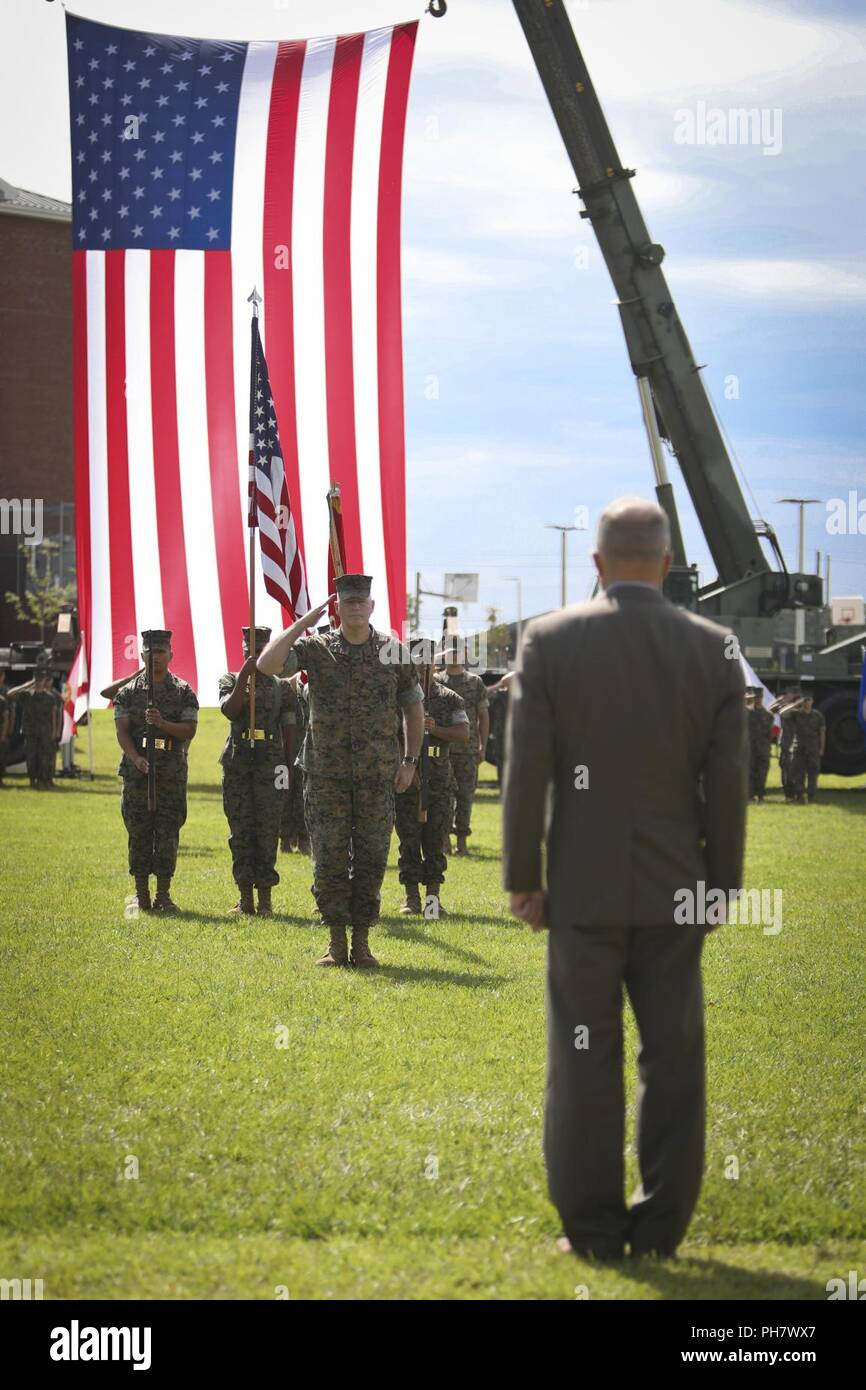 U.S. Marine Corps Maj. Gen. Niel E. Nelson, deputy commanding general of Marine Corps Combat Development Command, renders a salute to retired Lt. Gen. Frank A. Panter, during his retirement ceremony at Camp Lejeune, N.C., June 26, 2018. The ceremony was held in honor of Maj. Gen. Nelson's 35 years of honorable meritorious service. Stock Photo