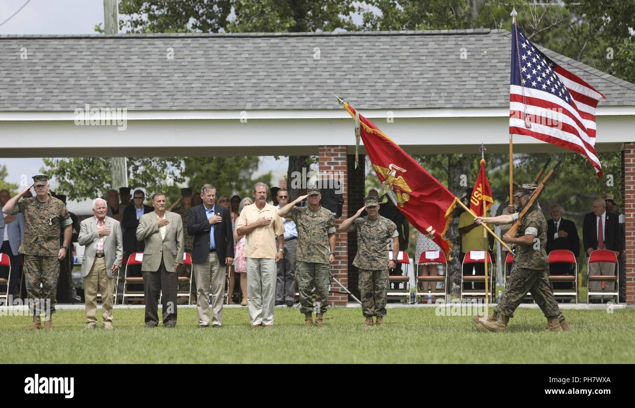 A U.S. Marine Corps Color Guard assigned to 2nd Marine Expeditionary Force conducts a pass and review during Maj. Gen. Niel E. Nelson's retirement ceremony at Camp Lejeune, N.C., June 26, 2018. The ceremony was held in honor of Maj. Gen. Nelson's 35 years of honorable and meritorious service. Stock Photo