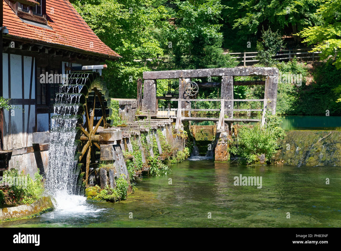 Historical hammer mill at the Blautopf, karst spring, water wheel, signal tower, Blaubeuren, Alb-Donau-Kreis, Swabian Alb Stock Photo