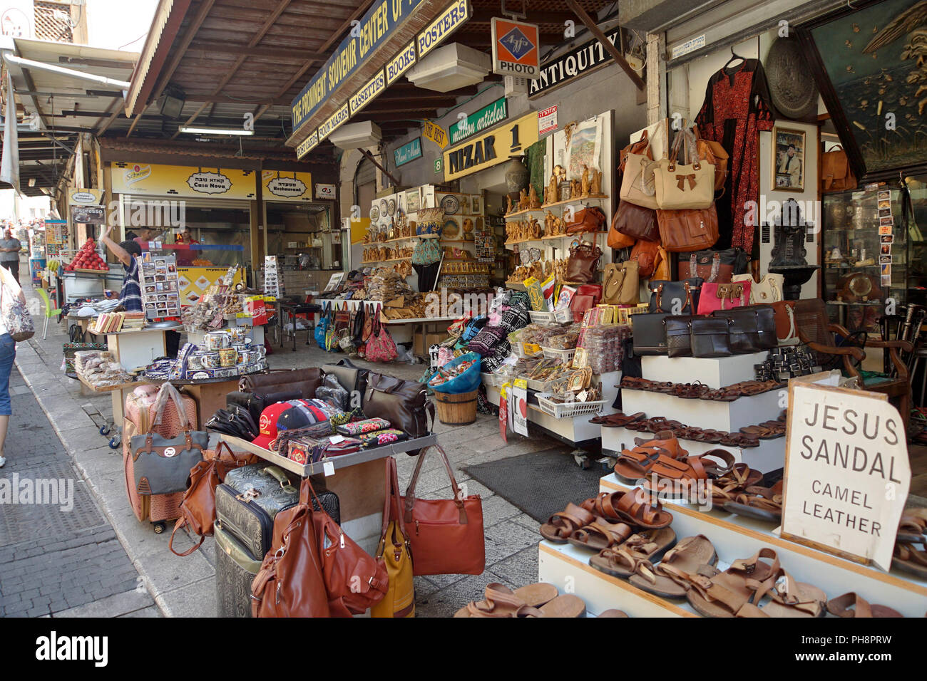 Tourist souvenirs for sale at the market in Nazareth, Israel - Stock Image