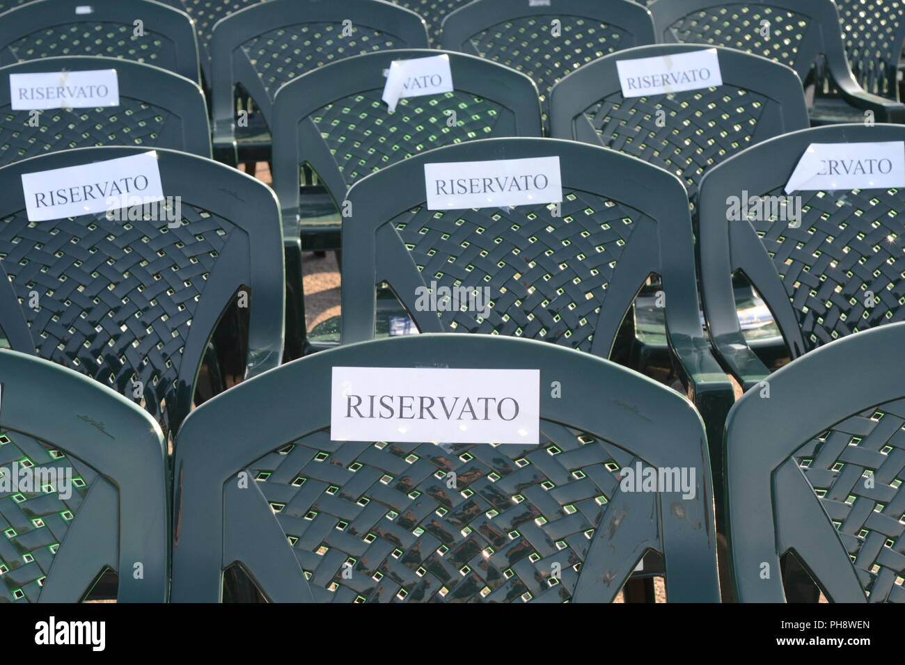 reserved seats in Italy for a public event - Stock Image