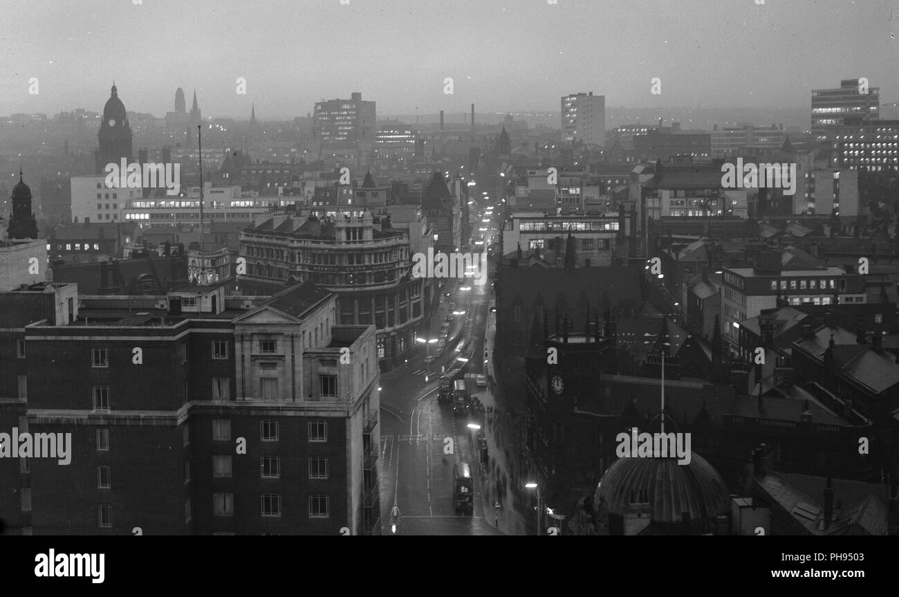 Leeds and city square from the roof at dusk - Stock Image