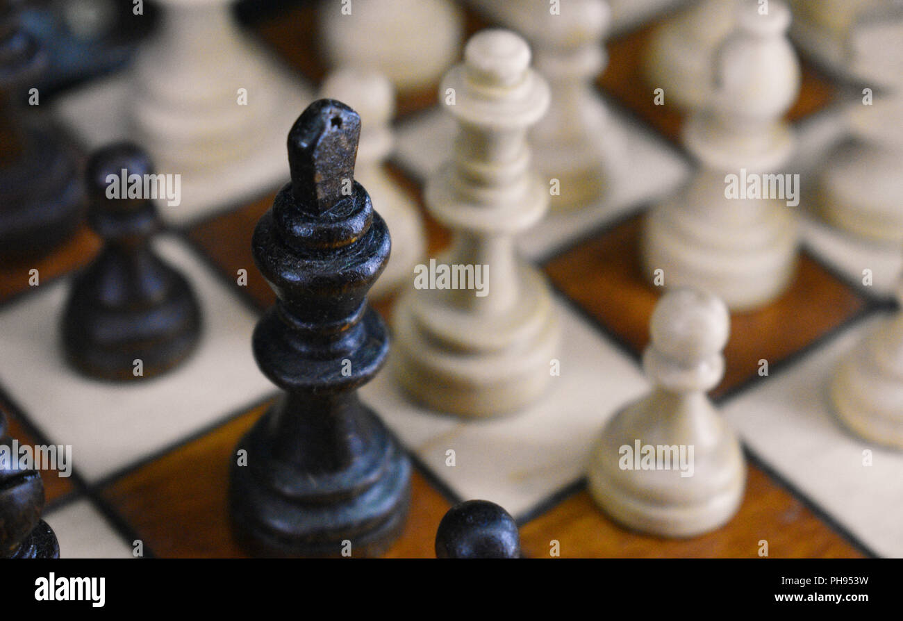 Chess board with a focus on the black king - Stock Photo