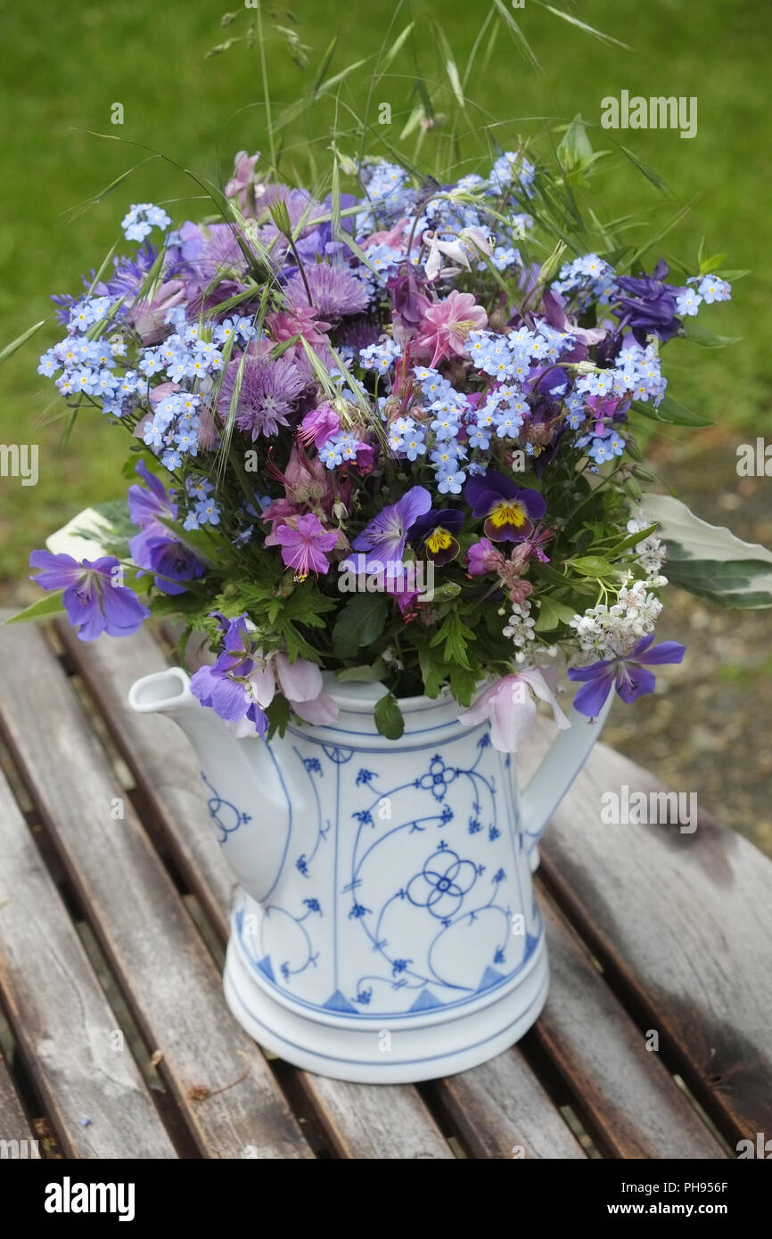 Wildflowers in a as a vase repurposed coffee pot - Stock Image