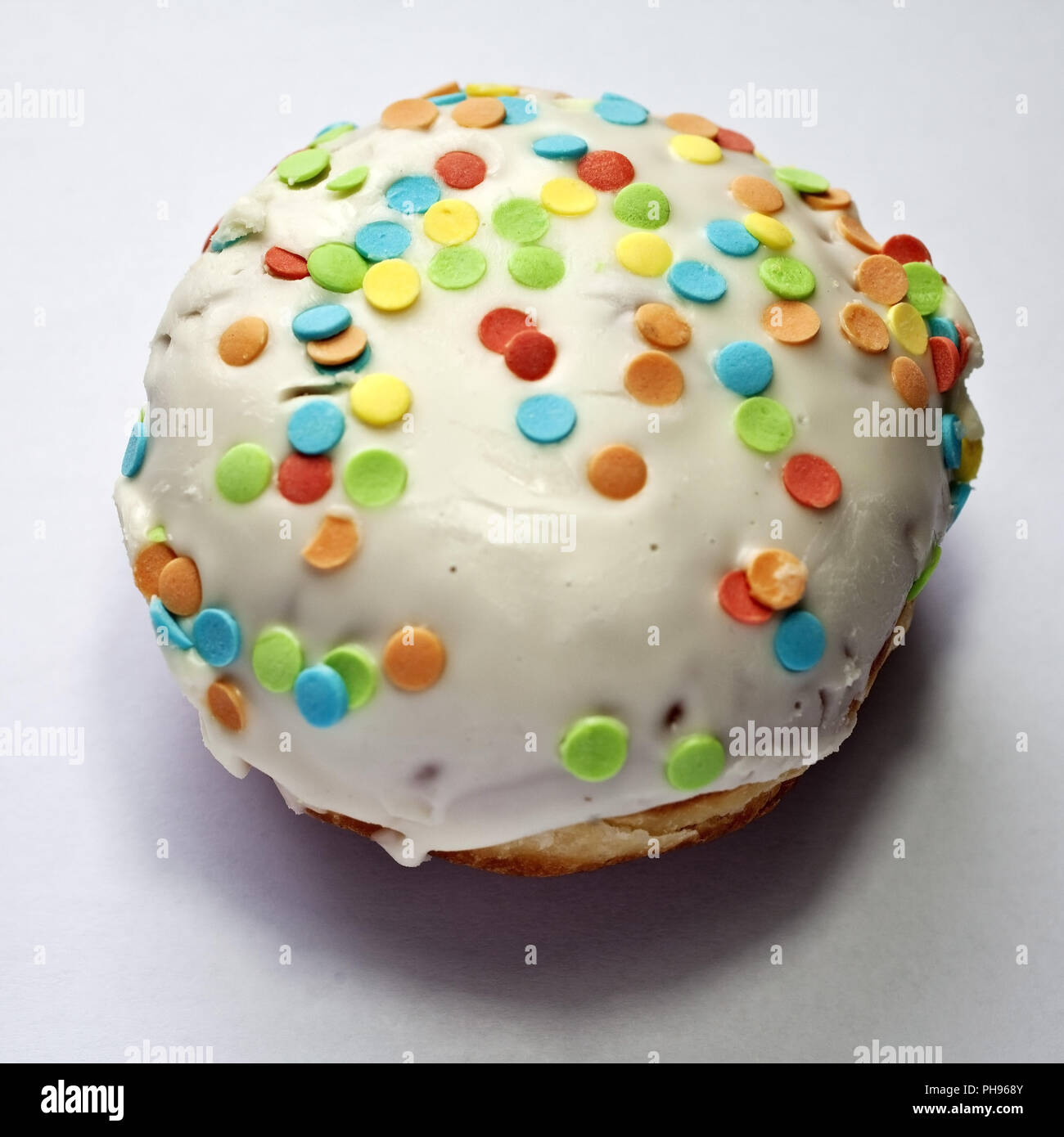 Carnival cake Berliner with simulated confetti - Stock Image