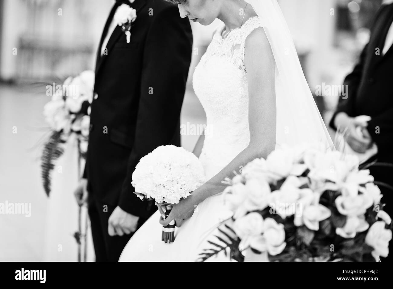 Black and white portrait of wedding couple at church - Stock Image