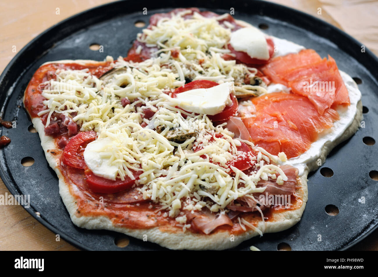 Homemade unbaked pizza prepared - Stock Image