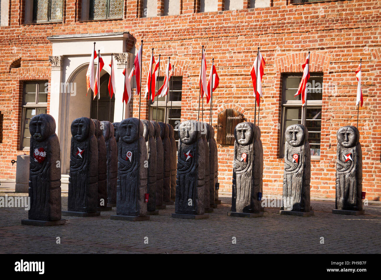 A group of sculptures imitating old pagan statues from Prussia. Olsztyn, Warmia, Poland. - Stock Image