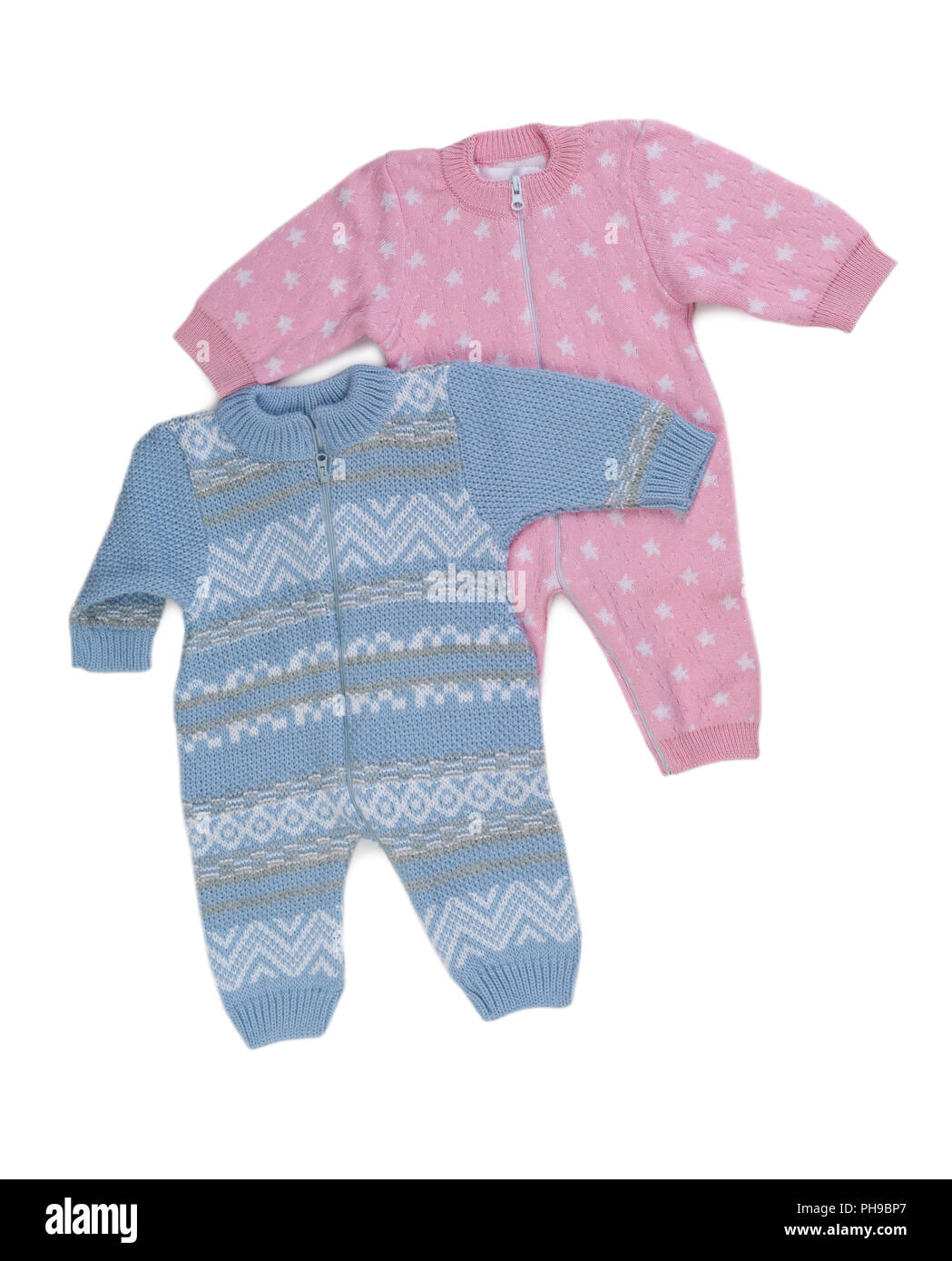 Two knitted pink and blue rompers. - Stock Image