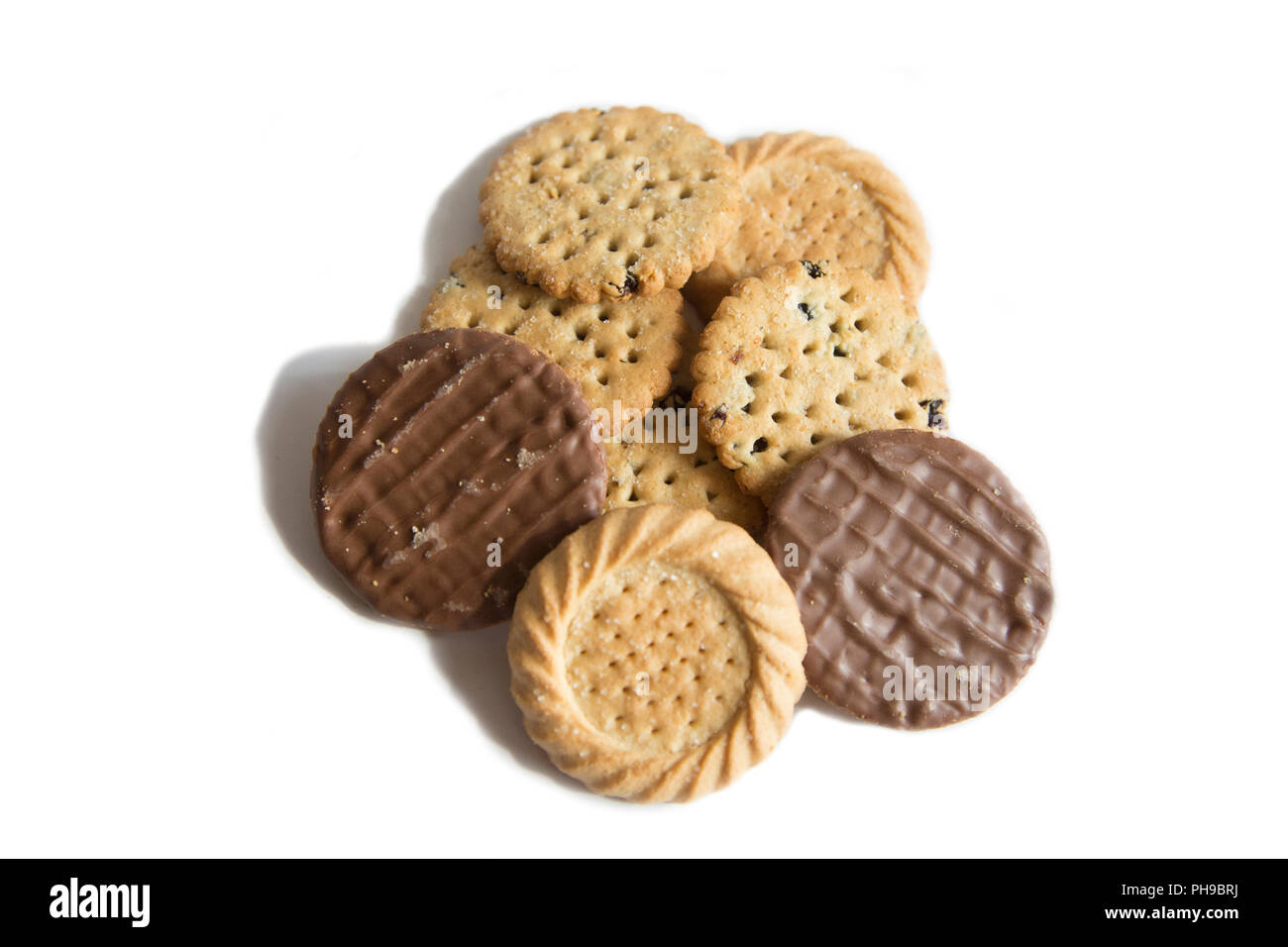 A pile of mixed biscuits ready to be eaten sitting on a clean white background - Stock Image
