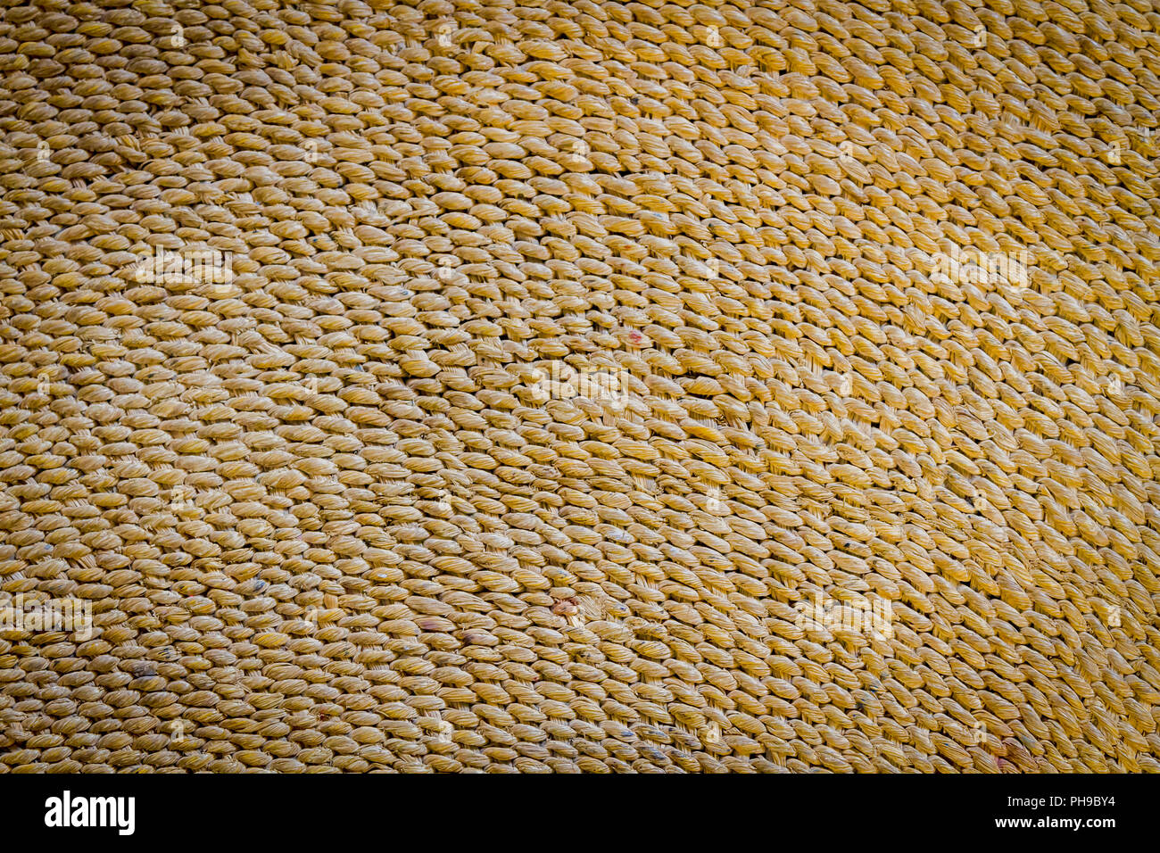 woven straw mat background,texture,wallpaper concept - Stock Image