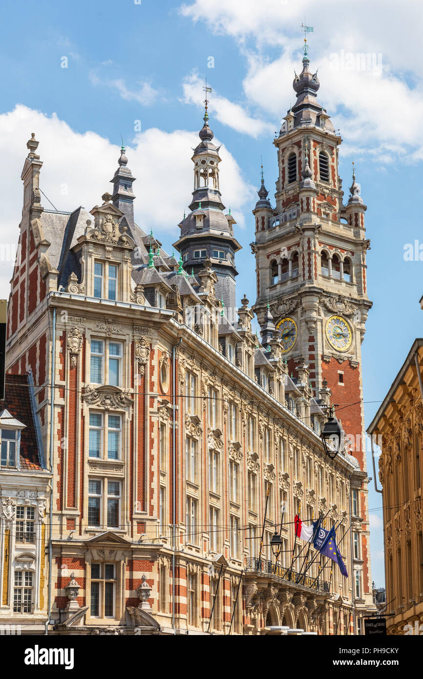 Architectural detail around Place du Theatre with the belfry and clock tower of the chamber of commerce, Lille, France - Stock Image