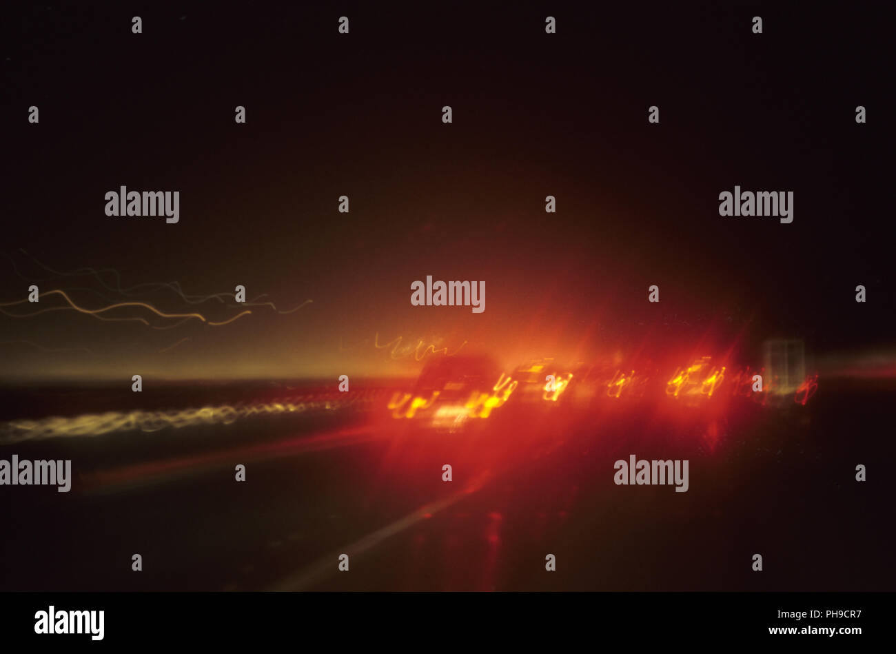 Brake lights in darkness - Stock Image