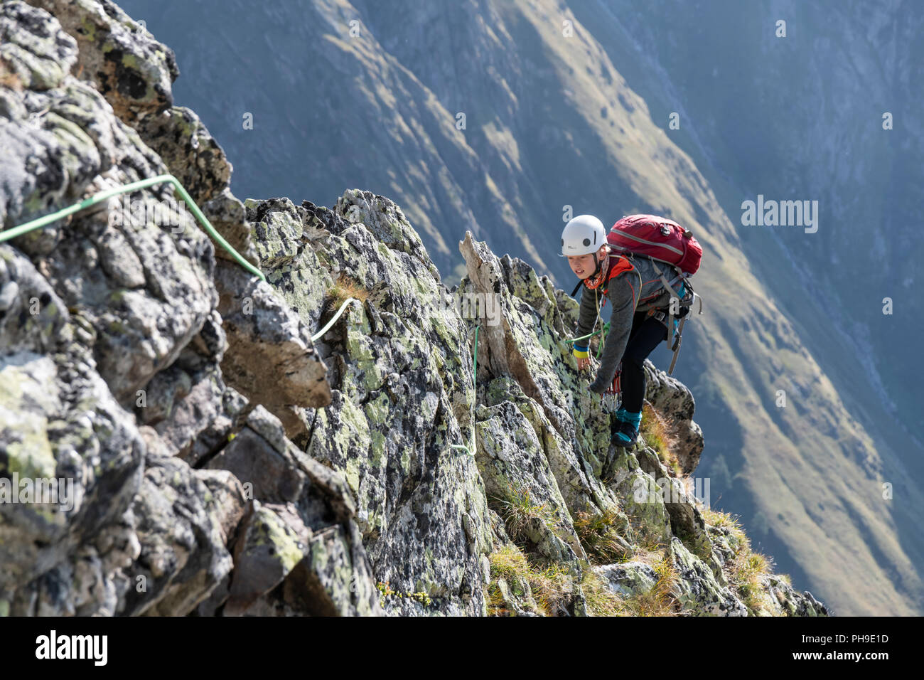 A young boy climbing in the Wiwannihorn in Switzerland Stock Photo