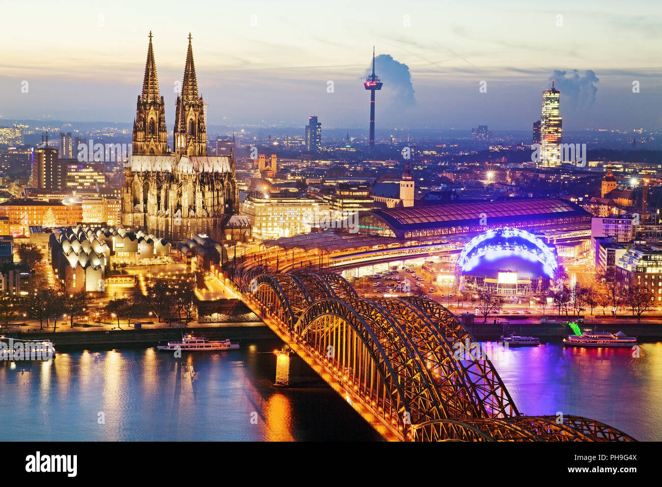 cityscape of Cologne with cathedral and brigde over Rhine at sunset, Cologne, Germany, Europe - Stock Image