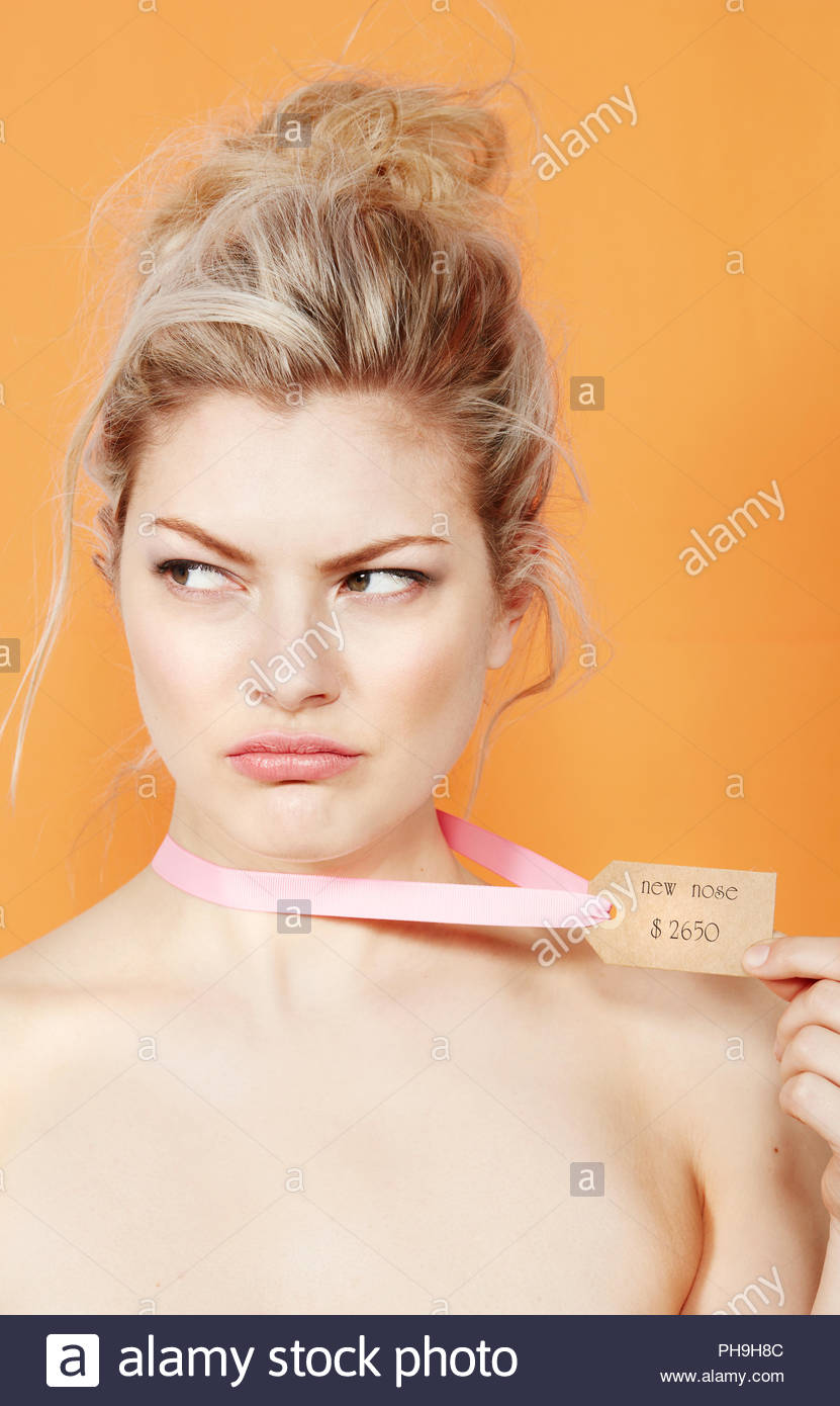 Young woman wearing price tag around her neck Stock Photo