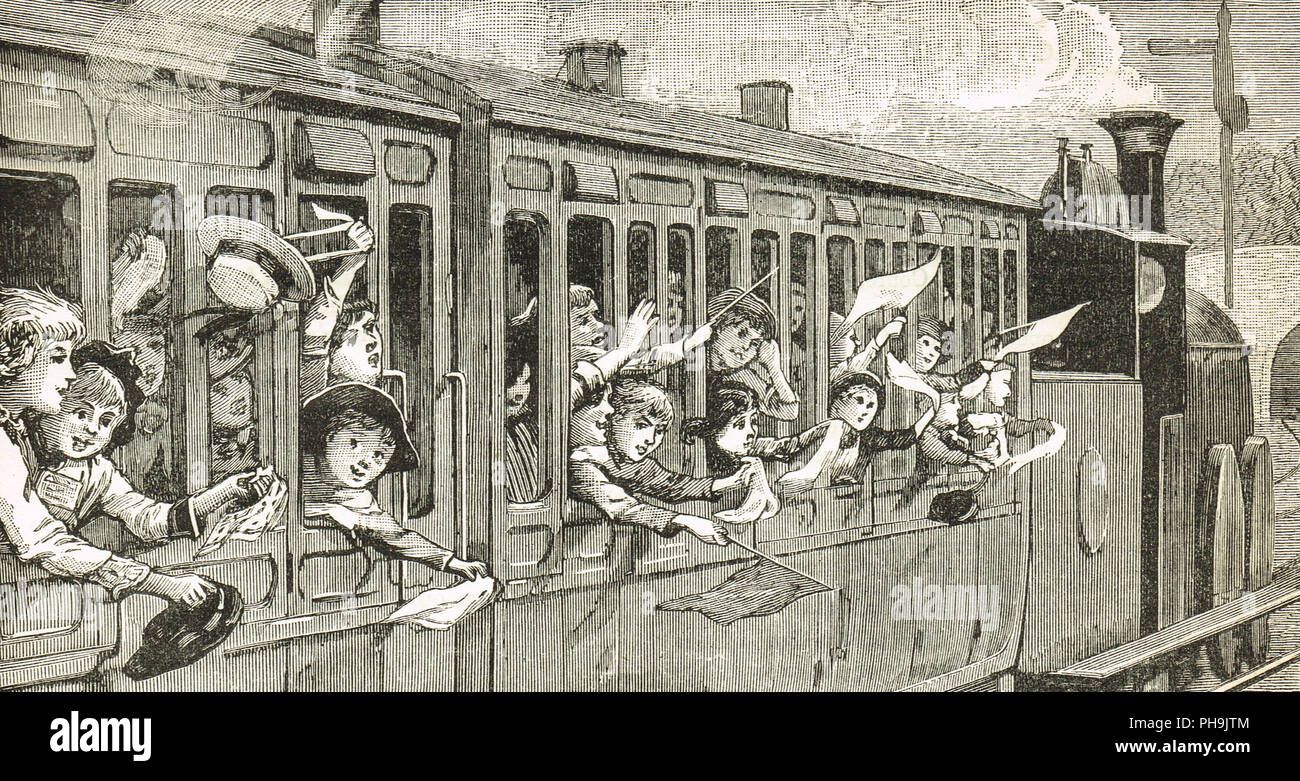 Victorian children on a steam train, waving flags, hankies and hats - Stock Image