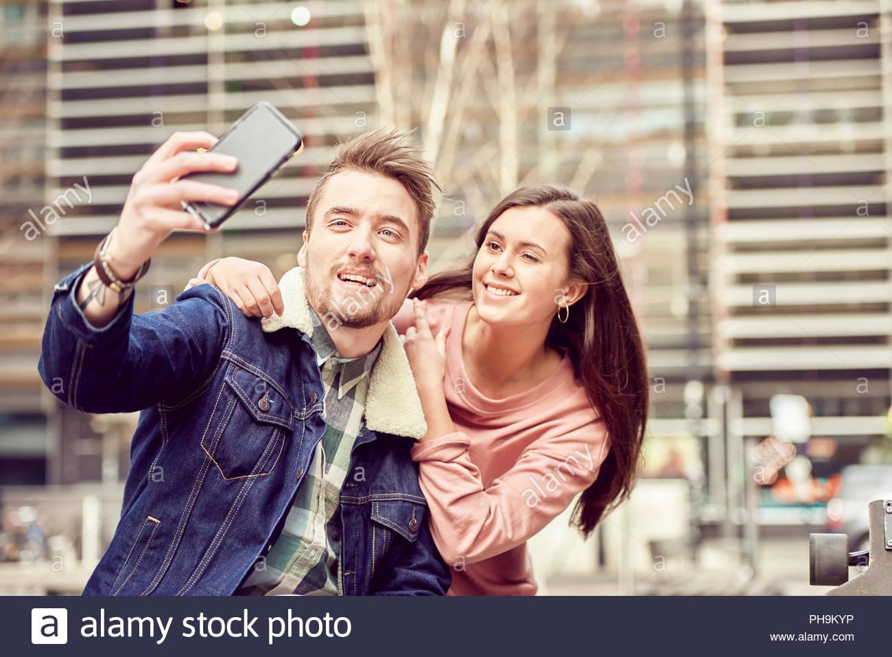 Teenage couple taking selfie together - Stock Image
