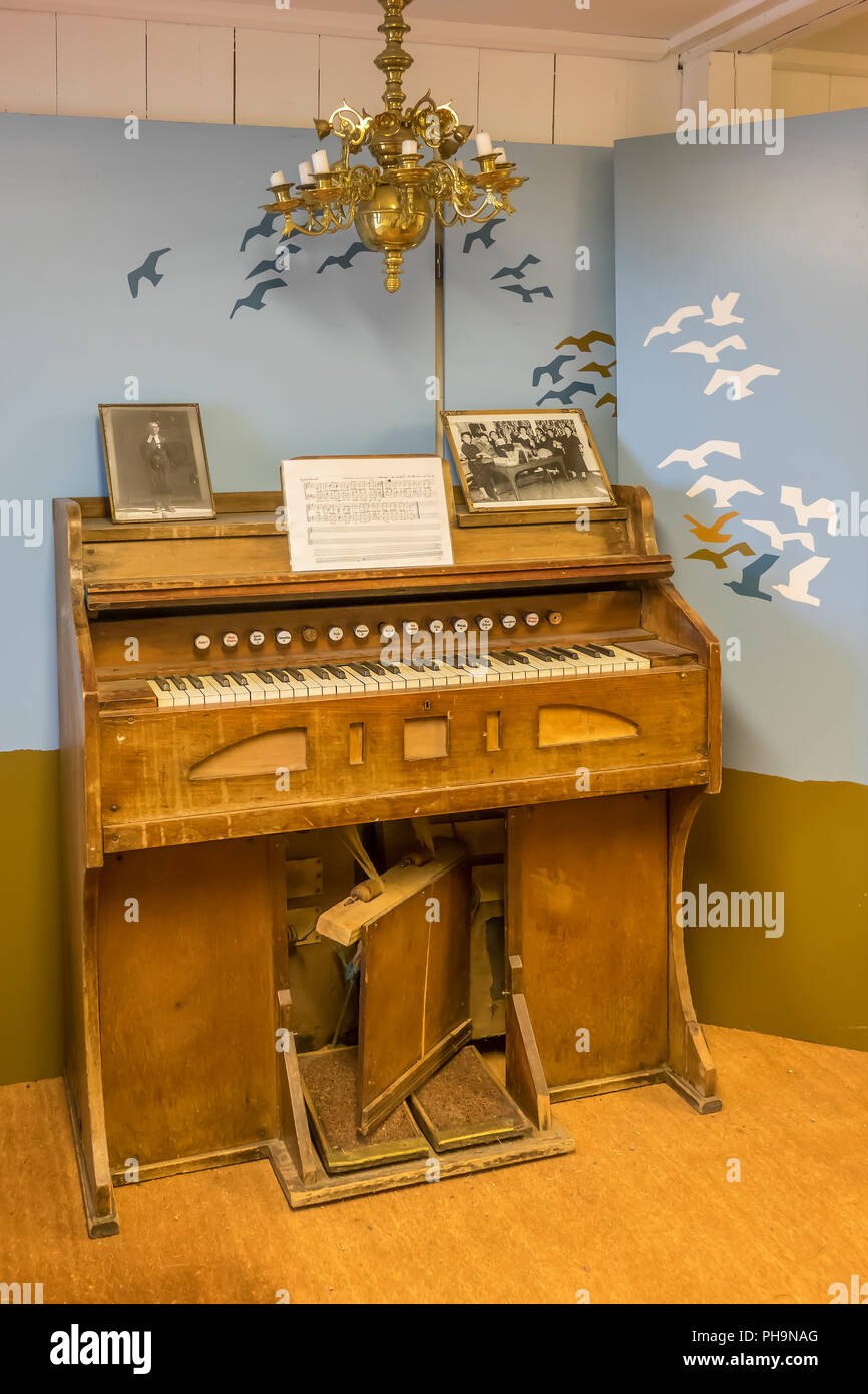 Denmark, Greenland, Nanortalik open air museum, music in living room - Stock Image