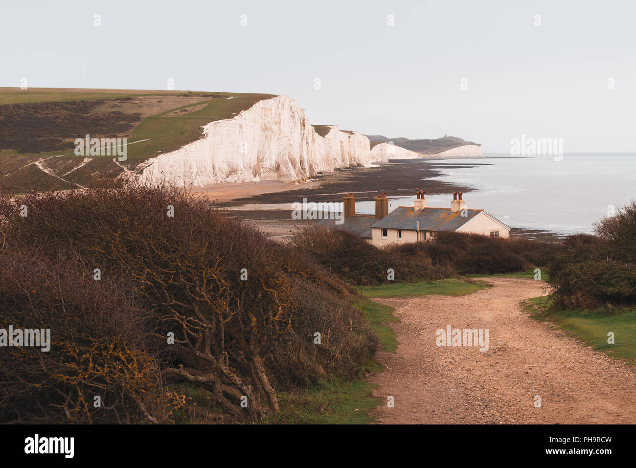Seven Sisters famous cliffs and road to coast guard cottages, Eastbourne, East Sussex, England - Stock Image