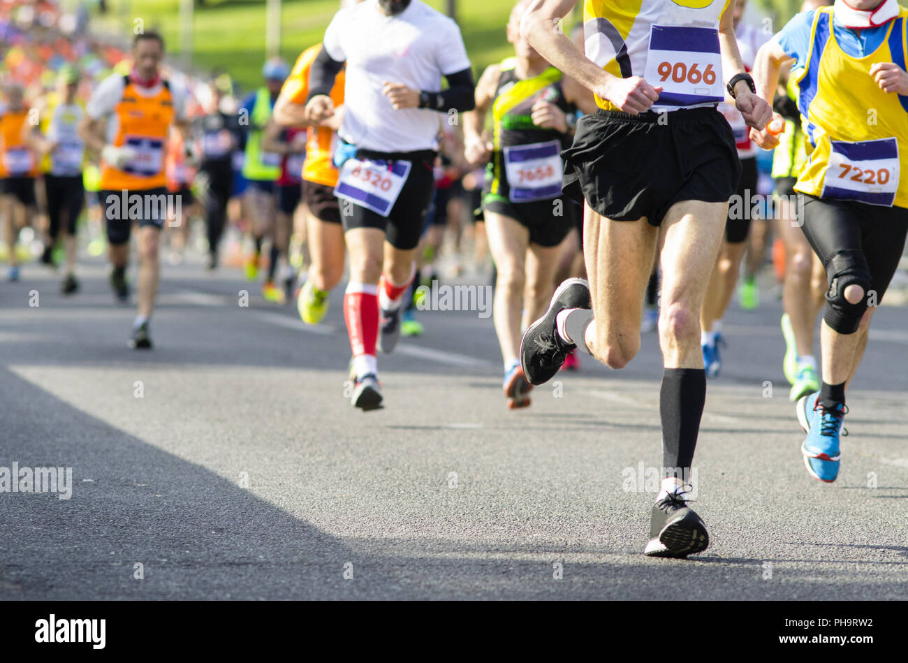 runners' legs during a marathon - Stock Image