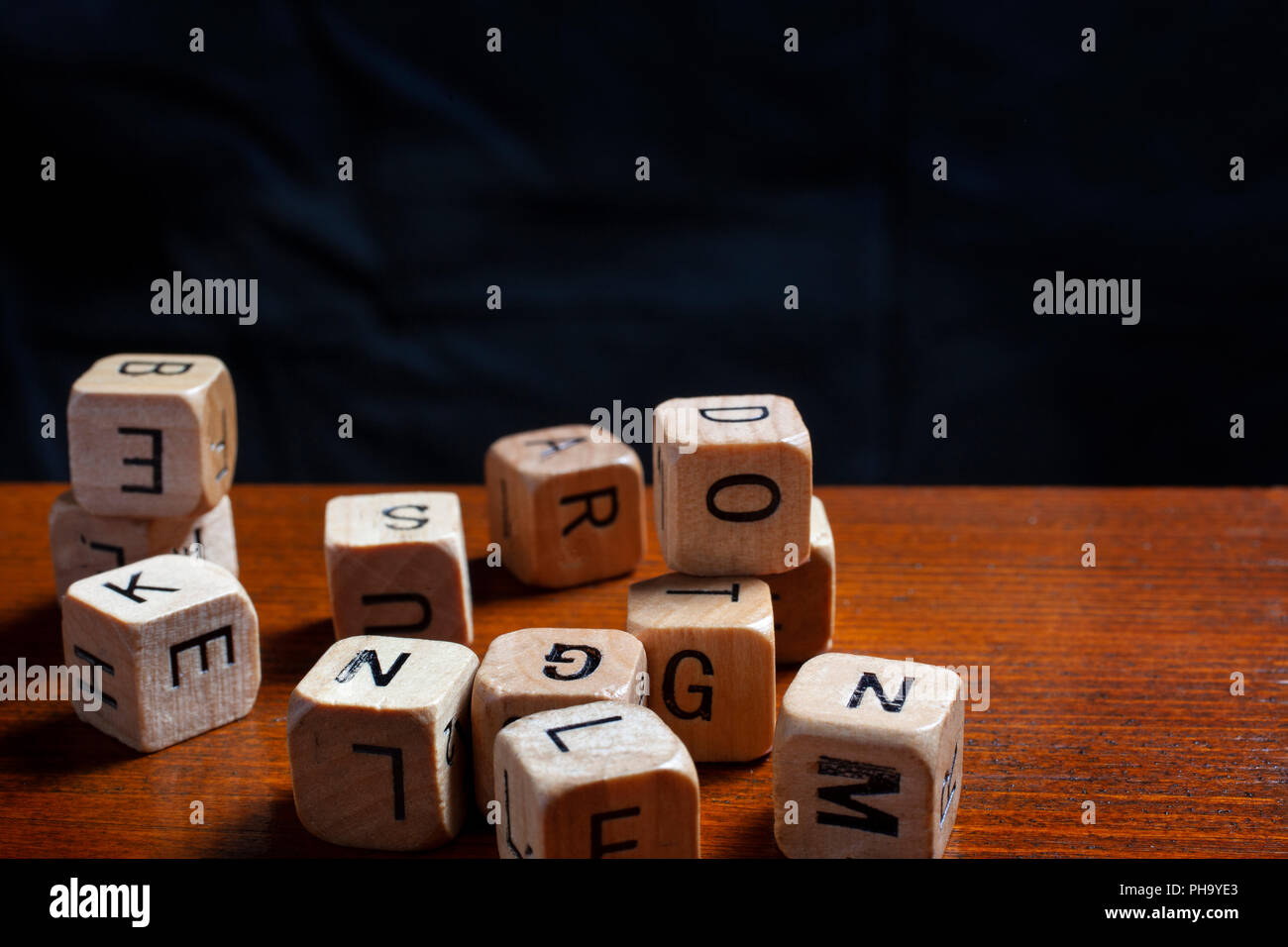 wooden letter dices - dyslexia concept - Stock Image