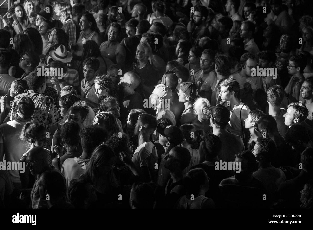 Imperia, Italy, 03.08.2018: group of people during an electronic music concert organized in the City of Imperia. - Stock Image