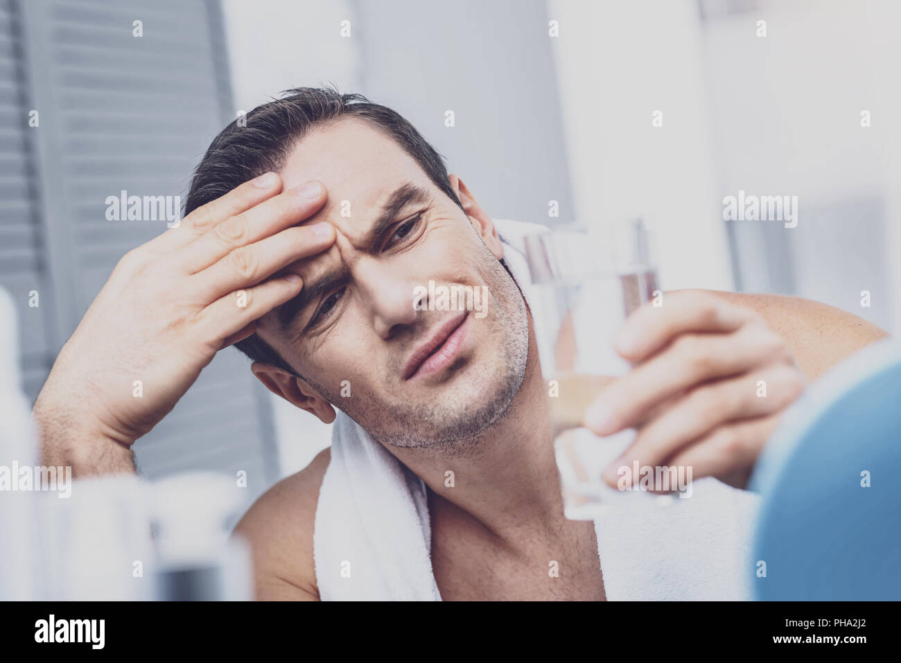 Wearied man having migraine - Stock Image
