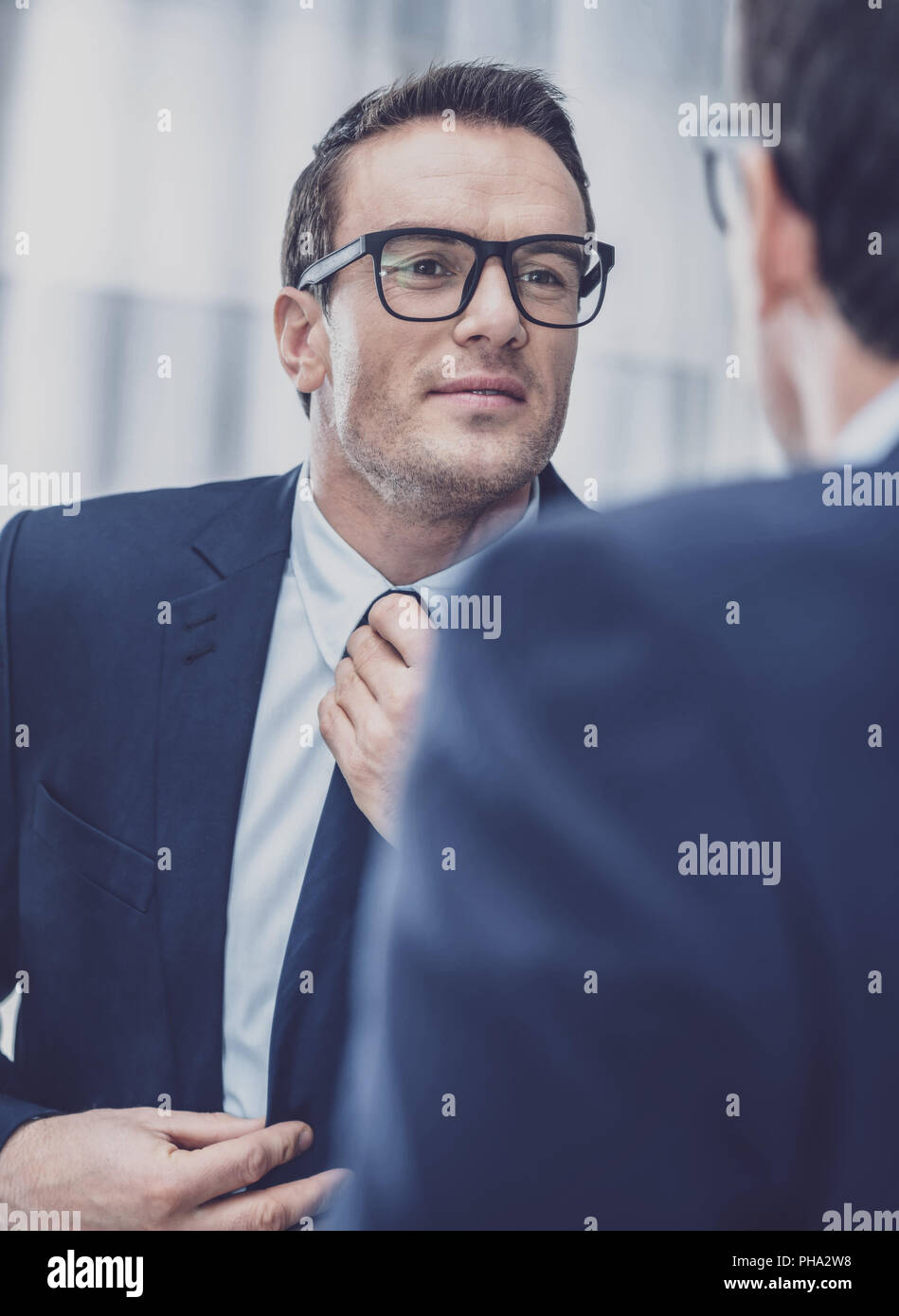 Handsome office worker going to job - Stock Image