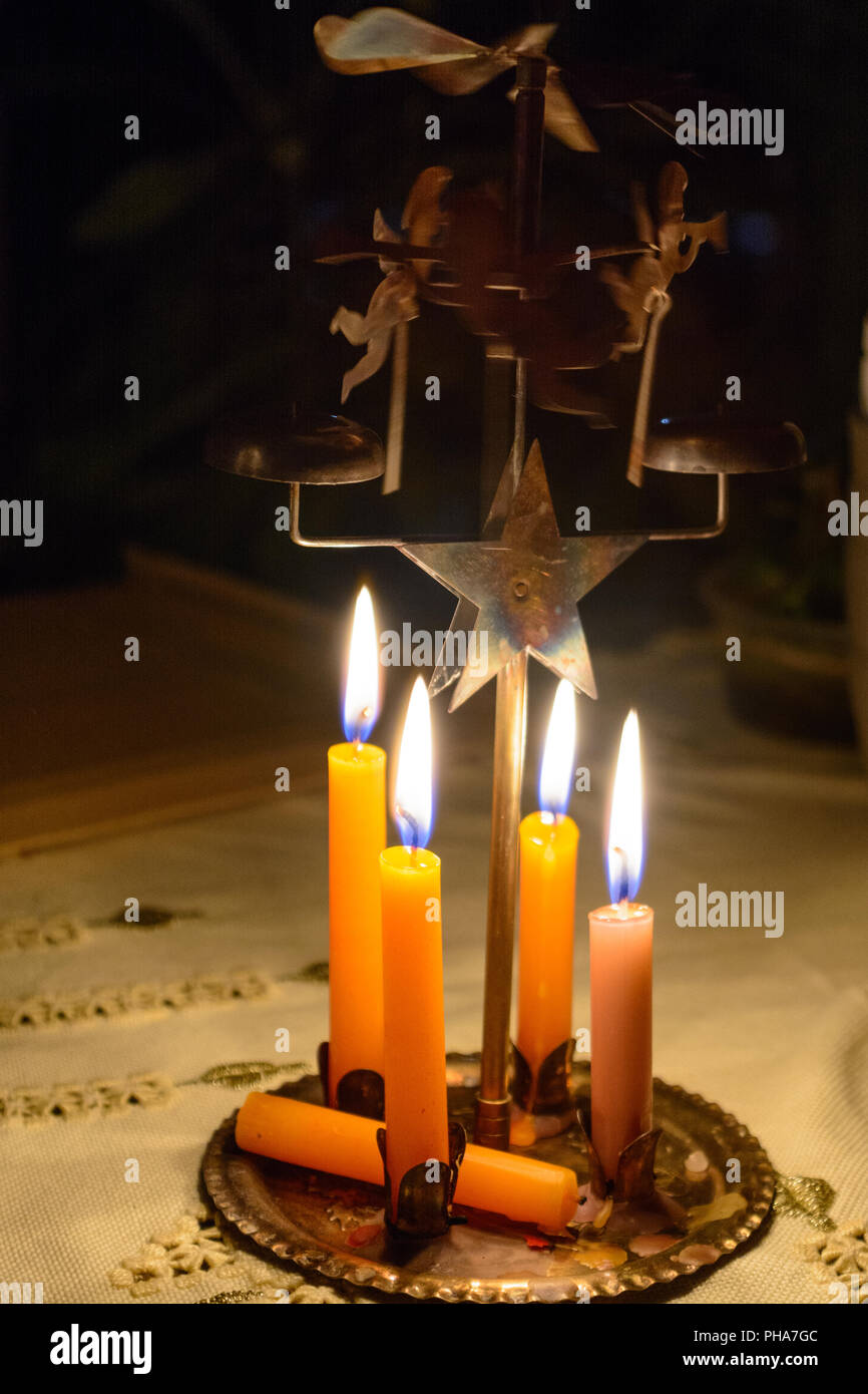 Burning Christmas tree candles perform a sentiimental bell ring - Stock Image