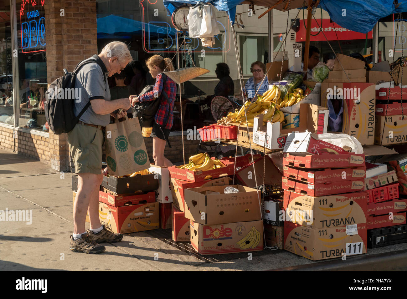 A fruit and vegetable vendor in the Chelsea neighborhood of New York on Saturday, August 25, 2018.  (© Richard B. Levine) Stock Photo