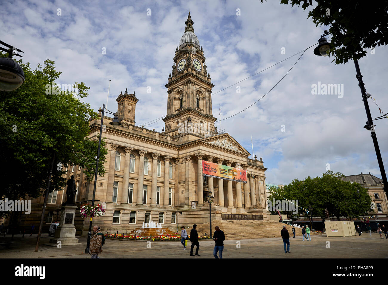 lancashire sandstone  landmark Grade II* listed building Bolton Town Hall facing Victoria Square designs by William Hill with baroque-style clocktower - Stock Image