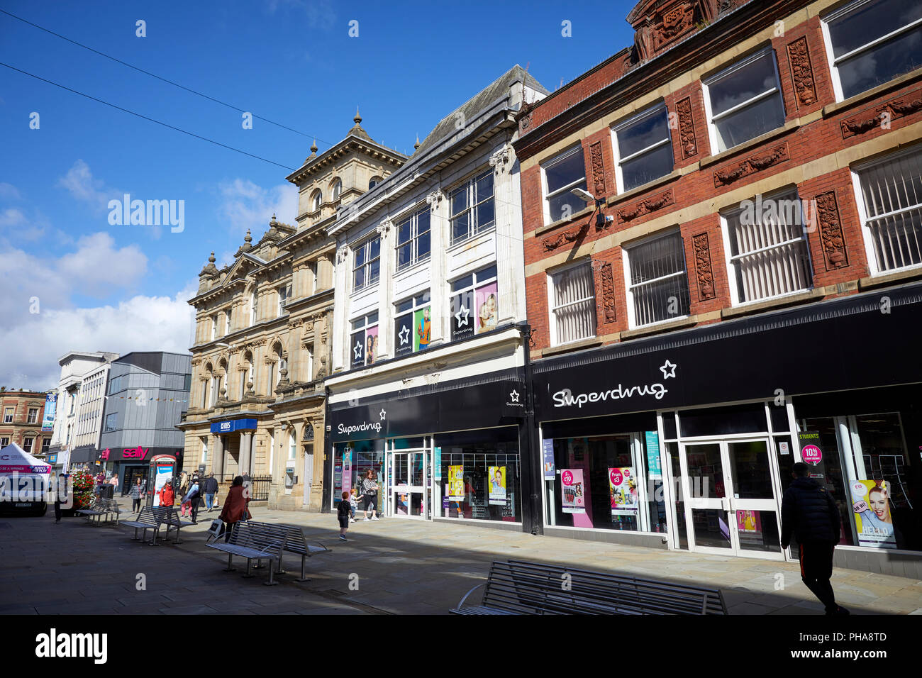 Superdrug and RBS on Deansgate the main shopping area in Bolton town centre Lancashire - Stock Image