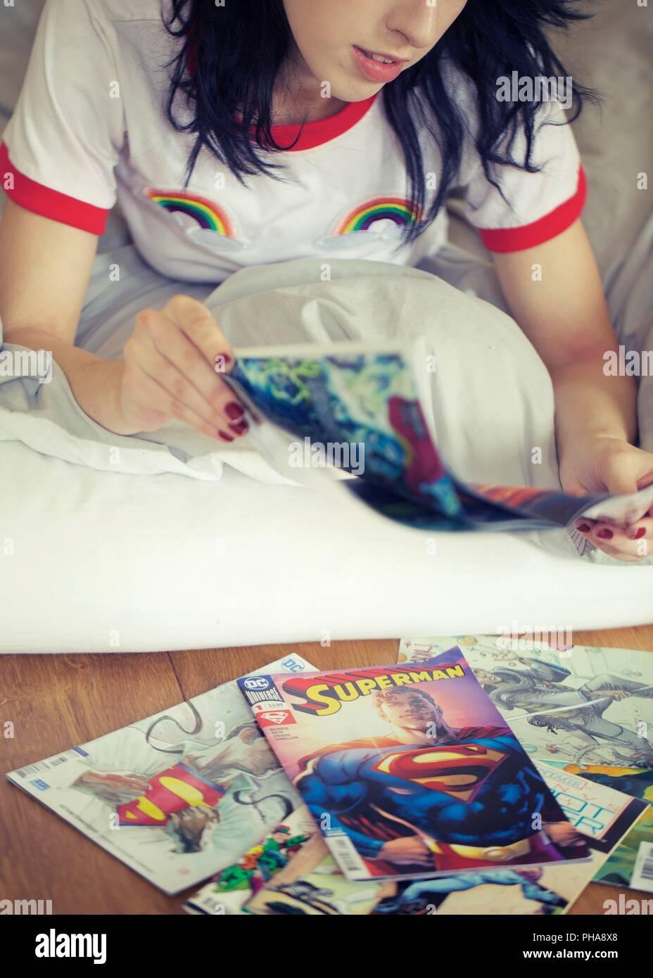girl reading comics - Stock Image