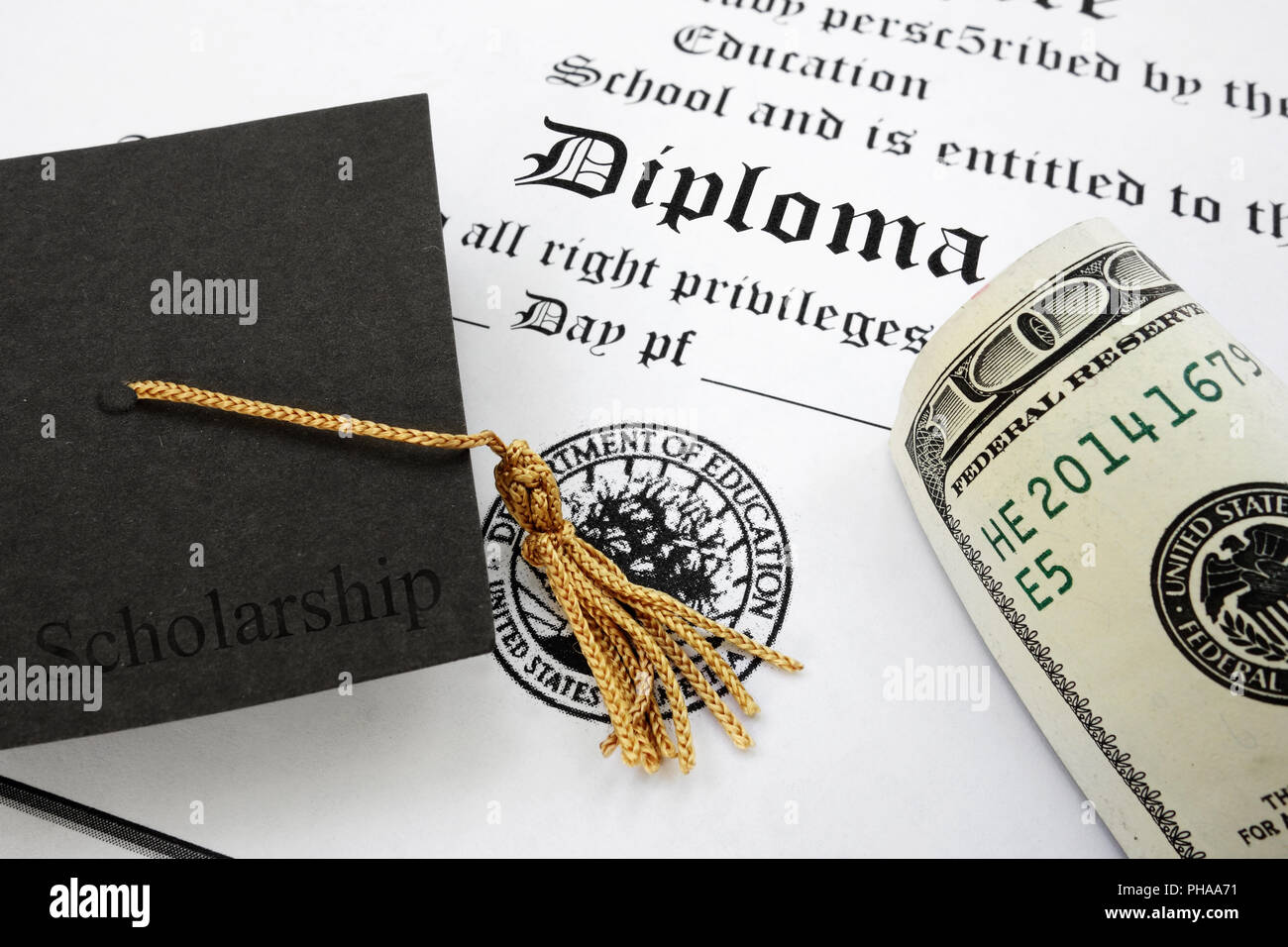 diploma and cash - Stock Image