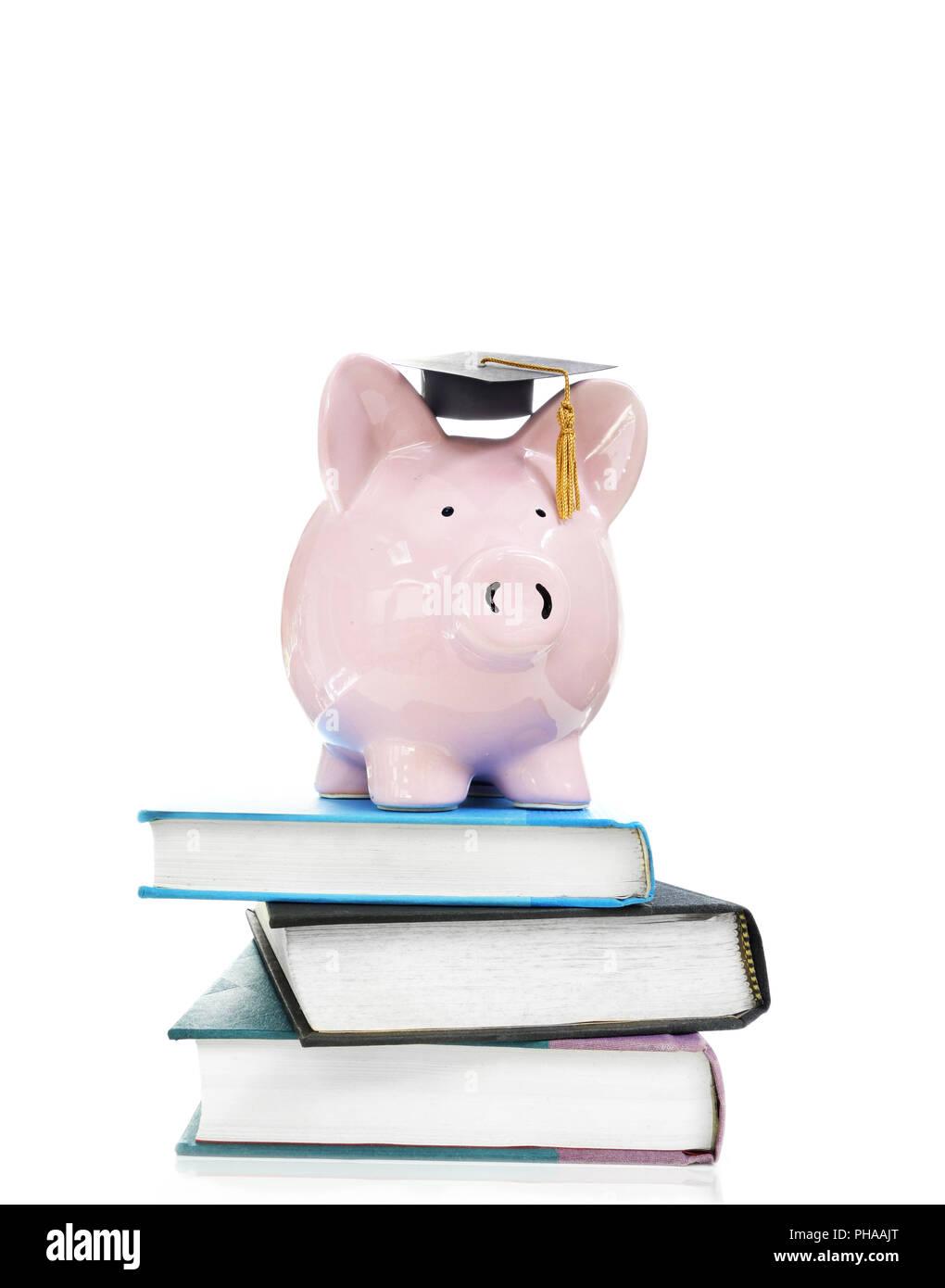 books and graduation piggy bank - Stock Image