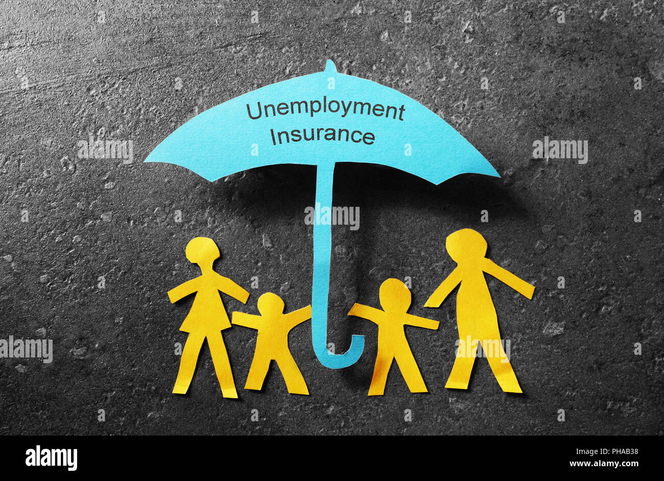 Unemployment Insurance umbrella - Stock Image