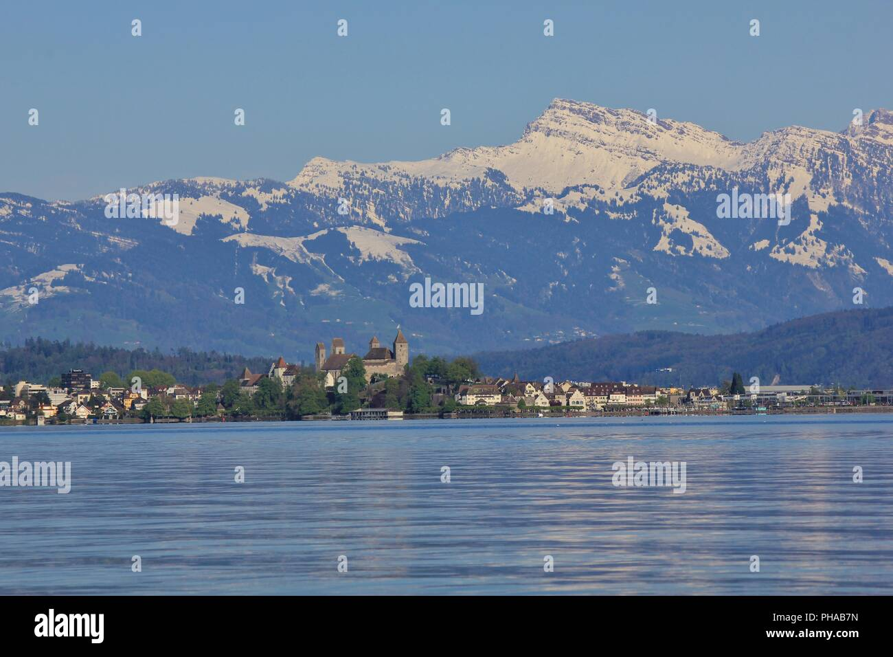 Lake Zurichsee and snow capped mountain Grosser Speer Stock Photo
