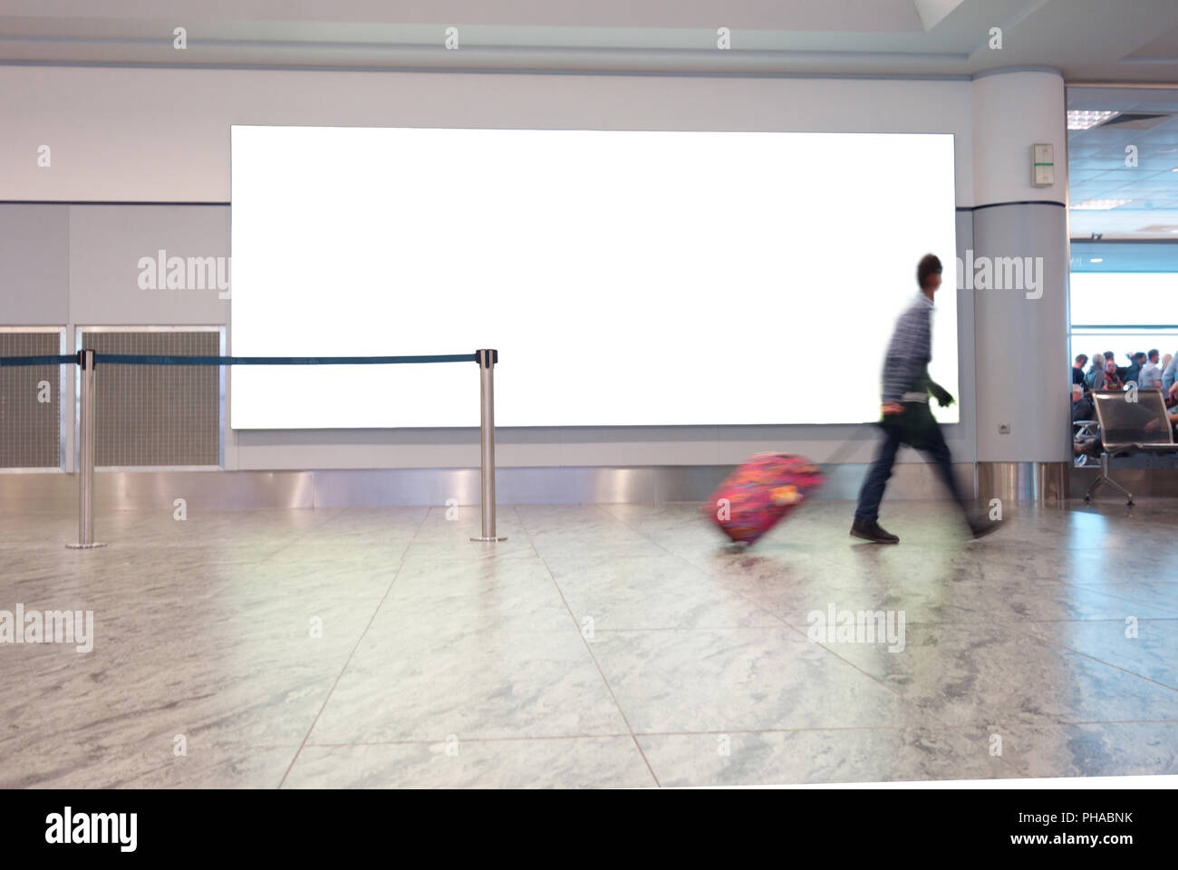 Airport traveller with blank sign - Stock Image