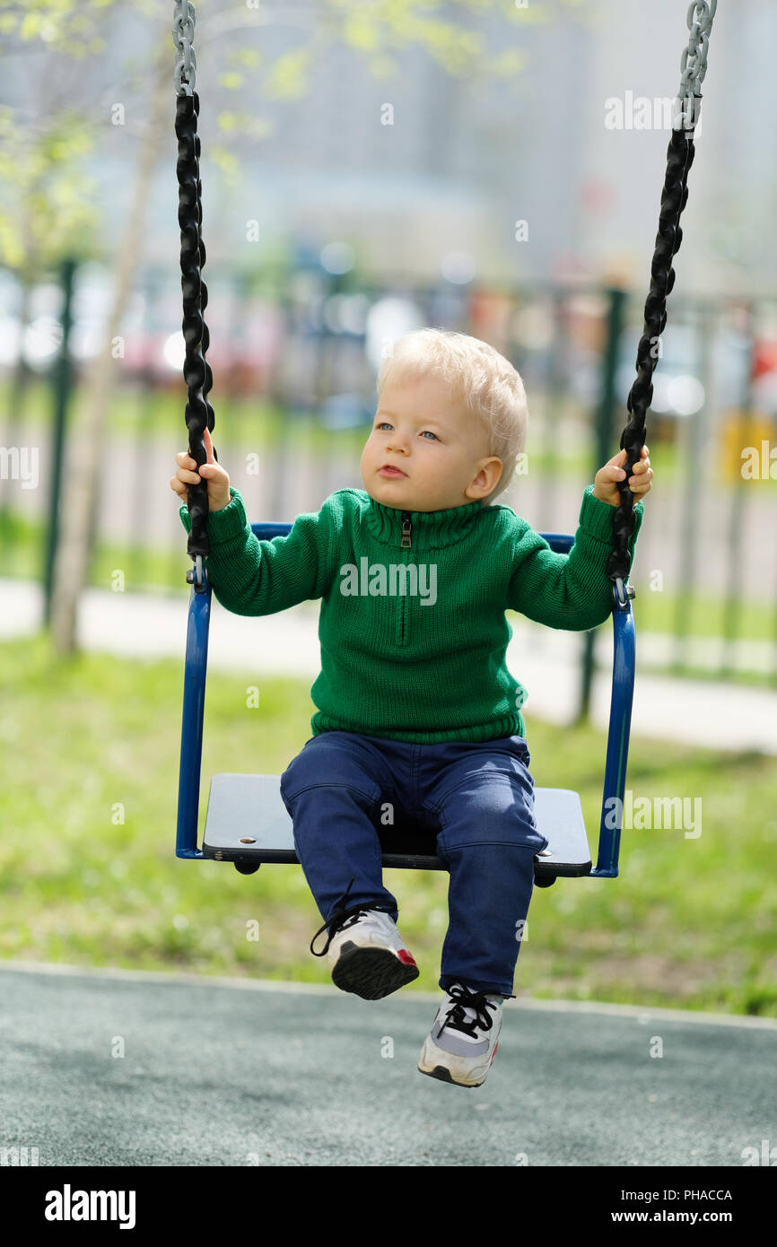 One year old baby boy toddler wearing green sweater at