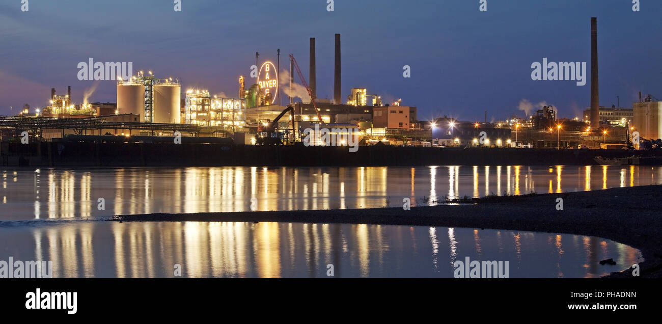 Bayer Cross in the blue hour, chemical factory at the Rhine, Leverkusen, Germany, Europe - Stock Image