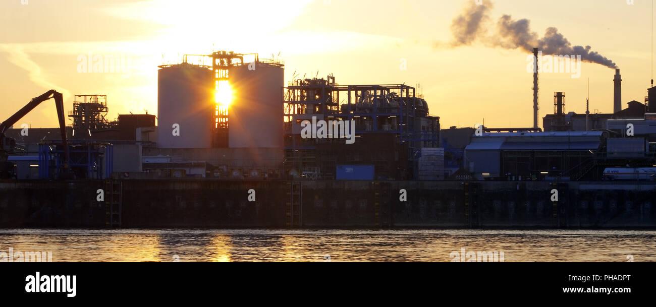 Bayer AG chemical plant on the Rhine riverbank at sunrise, Leverkusen, Germany, Europe - Stock Image