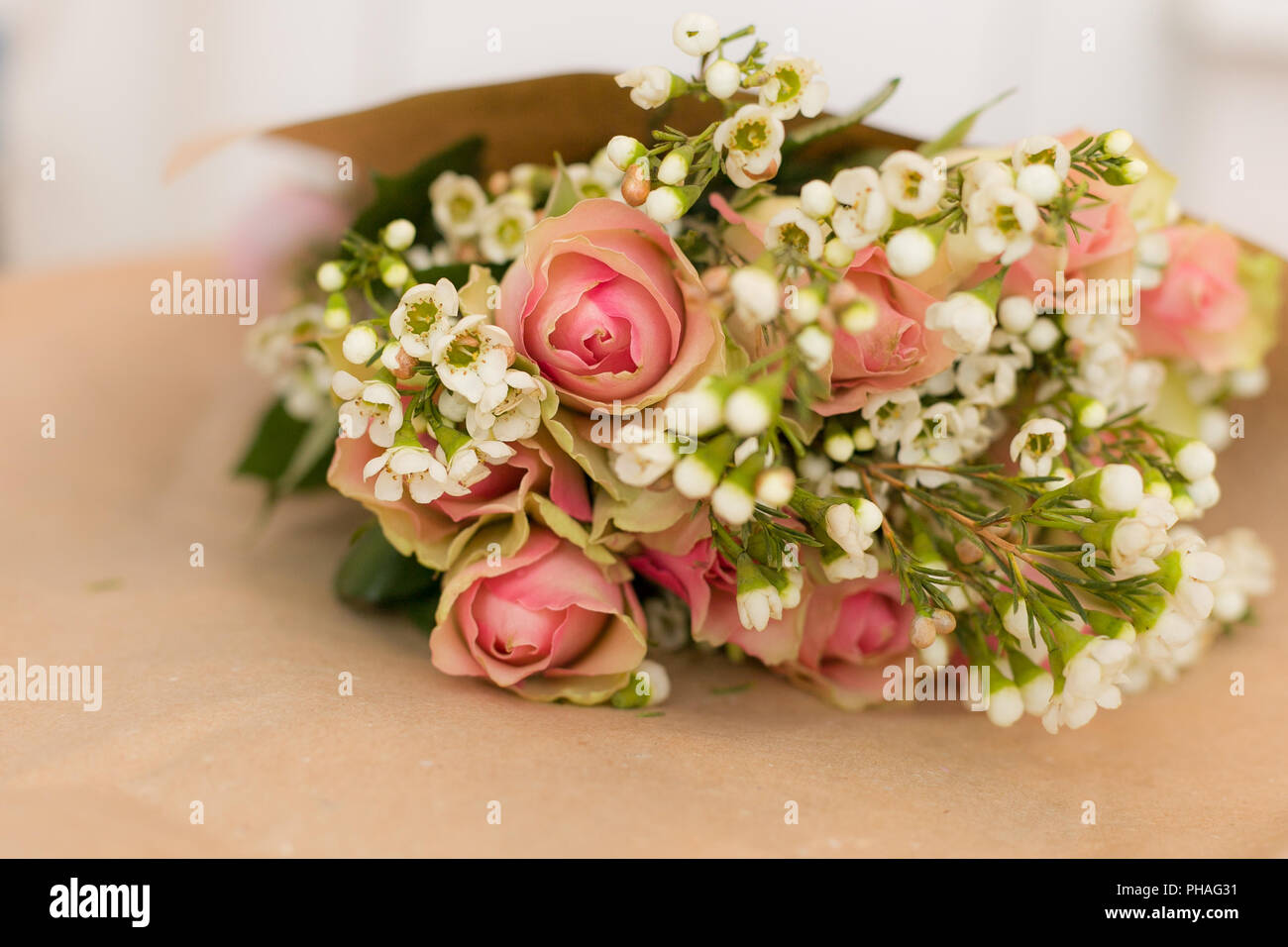 Beautiful bouquet of pink roses and daisies in the craft paper beautiful bouquet of pink roses and daisies in the craft paper flowers present for birthday stylish flower bunch ready for wrapping izmirmasajfo