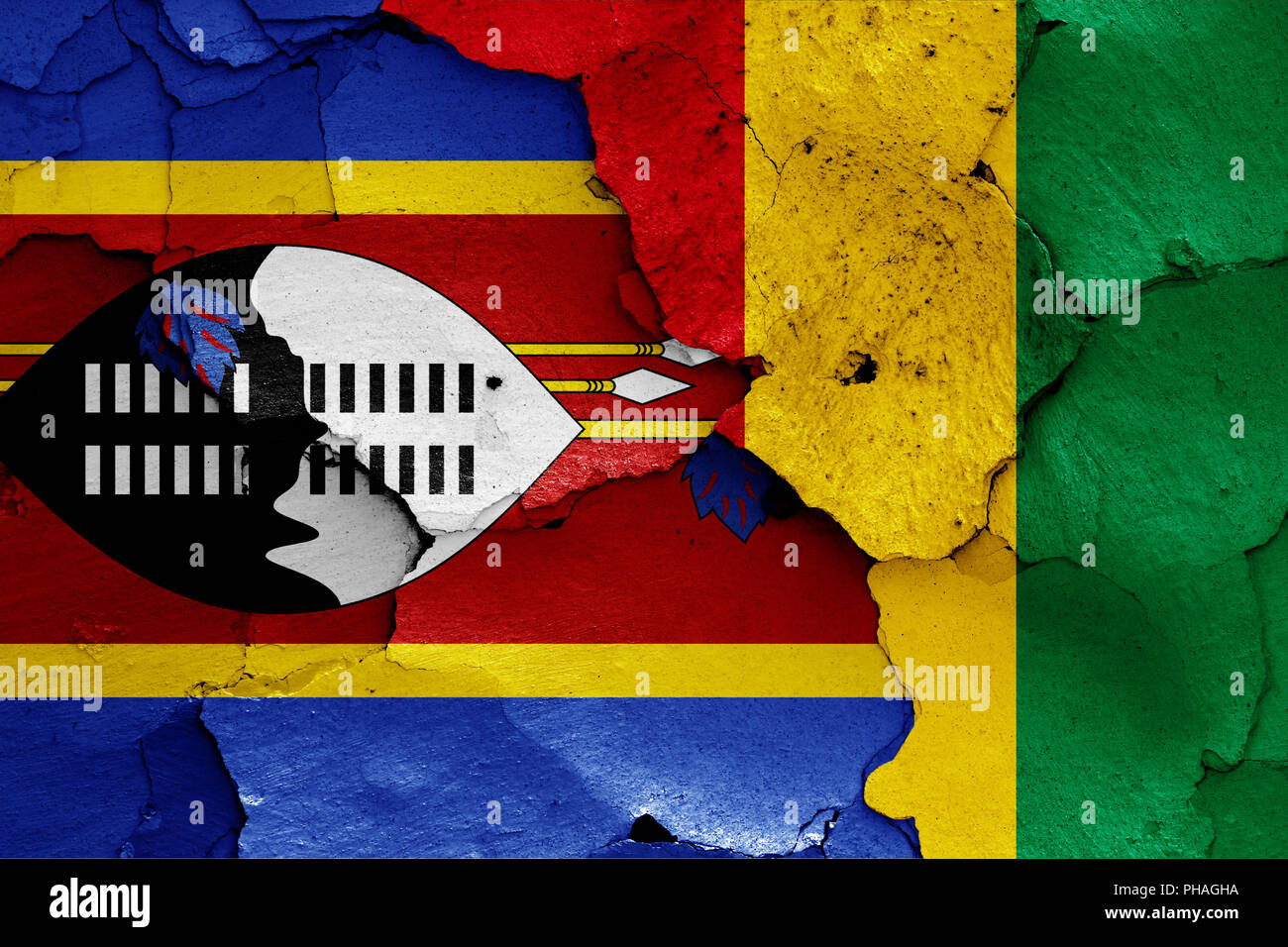 flags of Swaziland and Guinea painted on cracked wall - Stock Image
