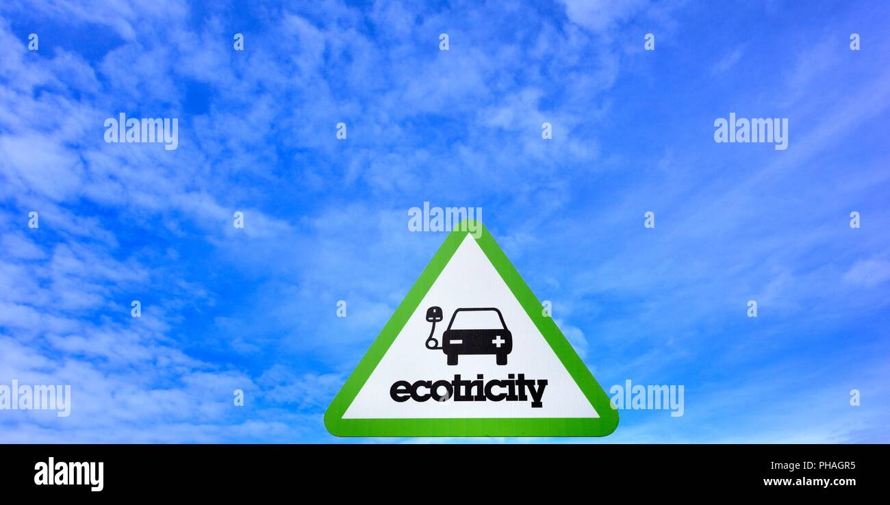 Ecotricity charging point sign blue sky - Stock Image