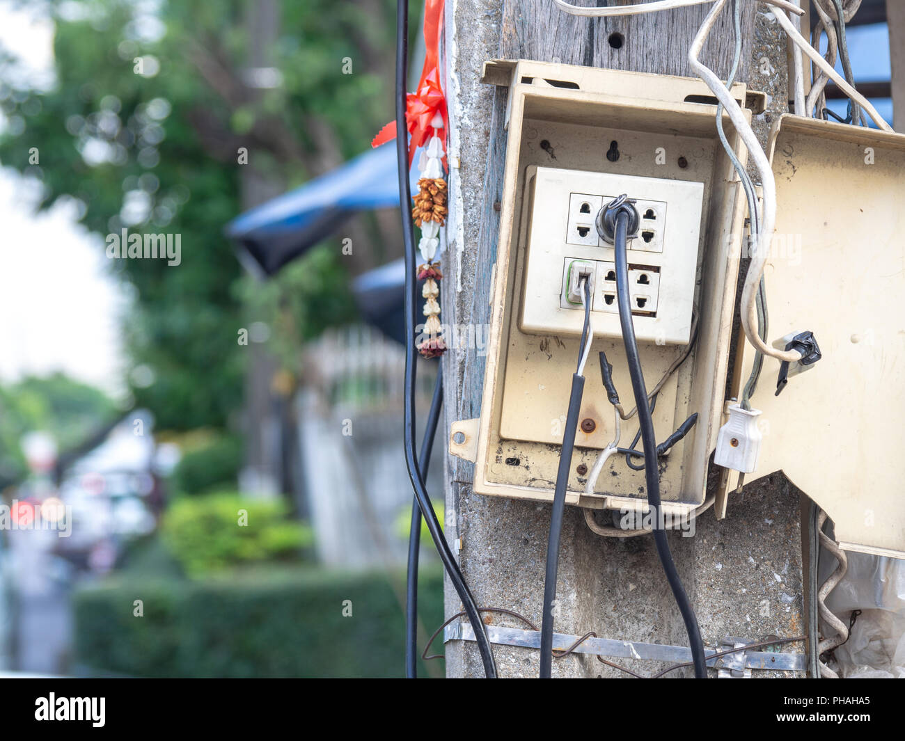 Power plugs are simple. And without regard to safety. Cause electric leak and fire. - Stock Image