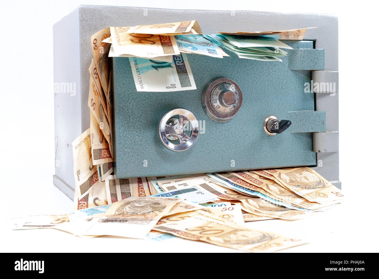 Safe Full Of Money Coming Out Stock Photo Alamy
