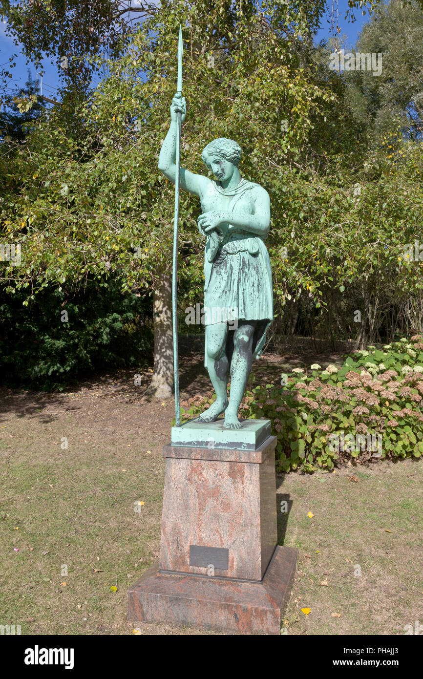 Wounded Amazon. Bronze cast of Roman copy after Greek original by Kresilas in the Botanical Gardens in Copenhagen. Greek original from about 450 B.C. Stock Photo