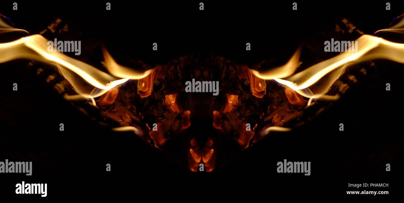 Symmetrical flame formation - Stock Image